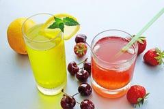 Refreshing fruit lemonade. Two glasses of ice-cold fruit lemonade and fresh fruits Royalty Free Stock Photo