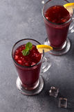 Refreshing fruit punch beverage in glass Stock Image