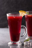 Refreshing fruit punch beverage in glass Stock Images