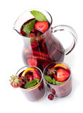 Refreshing fruit sangria in jug and two glasses Royalty Free Stock Image