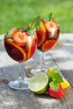 Refreshing fruit sangria (punch). On wood table Stock Image