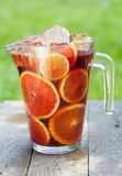 Refreshing fruit sangria (punch). On wood table Stock Photos