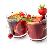 Refreshing fruit sangria in two glasses Stock Photos