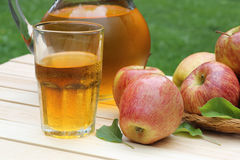 Refreshing Glass of Apple Juice. With apples on the side Royalty Free Stock Photos