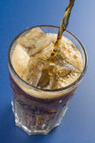 Refreshing glass of cola with lemon and ice Stock Photos