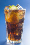 Refreshing glass of cola with lemon and ice Stock Images