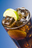 Refreshing glass of cola with lemon and ice Royalty Free Stock Photography