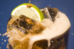 Refreshing glass of cola with lemon and ice Stock Photography
