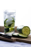 Refreshing glass of cucumber water. A refreshing glass of cucumber water with cucumber slices on the side.  Summer Beverage.  Healhy hydration Stock Photos