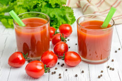 Refreshing glass of tomato juice. With vegetables on background Royalty Free Stock Photography