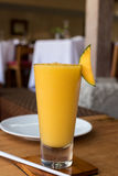 Refreshing glass of tropical mango juice on a wooden table. Bali island, Indonesia. Stock Photography