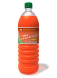 Refreshing grapefruit drink in plastic bottle Royalty Free Stock Photography