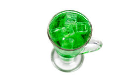 Refreshing green fizzy soft drink with ice in transperant glass Royalty Free Stock Images