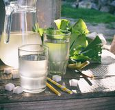 Refreshing healthy summer drink with rhubarb. Pieplant lemonade in glass on wooden background. Homemade rhabarbarum compote. Refreshing healthy summer drink Stock Image