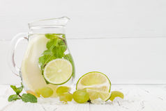 Refreshing homemade lime and mint cocktail over old vintage wooden table. Detox fruit infused flavored water. Clean eating. Copy space background royalty free stock photos