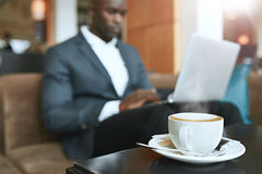 Refreshing hot cup of coffee on table at hotel lobby Royalty Free Stock Photo
