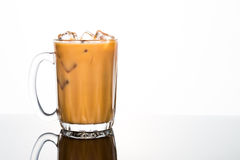 Refreshing ice cold coffee with milk in transparent glass Royalty Free Stock Photos