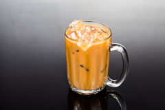 Refreshing ice cold coffee with milk in transparent glass Stock Image