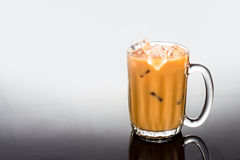 Refreshing ice cold coffee with milk in transparent glass Stock Photography
