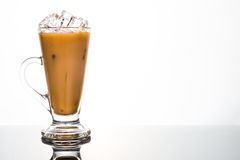 Refreshing ice cold coffee with milk in transparent glass Stock Images