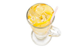 Refreshing ice cold ginger lemon tea in transparent glass.  Royalty Free Stock Photo