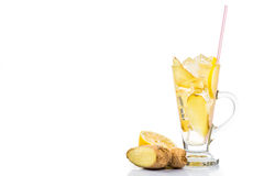 Refreshing ice cold ginger lemon tea in transparent glass Stock Photos