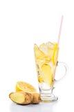 Refreshing ice cold ginger lemon tea in transparent glass on vertical format.  Stock Image
