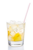 Refreshing ice cold ginger lemon tea in transparent glass on vertical format.  Royalty Free Stock Image