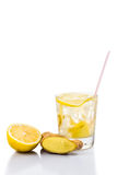 Refreshing ice cold ginger lemon tea in transparent glass on vertical format.  Royalty Free Stock Photo