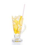 Refreshing ice cold ginger lemon tea in transparent glass on vertical orientation.  Royalty Free Stock Images