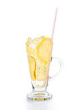 Refreshing ice cold ginger lemon tea in transparent glass on vertical orientation.  Stock Photography