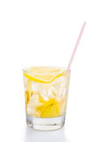 Refreshing ice cold ginger lemon tea in transparent glass on vertical orientation Stock Photography