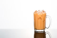 Refreshing ice cold tea with milk in transparent glass Stock Image
