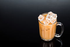 Refreshing ice cold tea with milk in transparent glass Royalty Free Stock Images