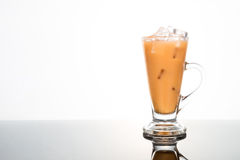 Refreshing ice cold tea with milk in transparent glass Stock Photography