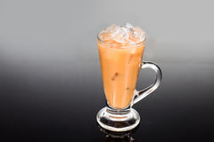 Refreshing ice cold tea with milk in transparent glass Royalty Free Stock Photo