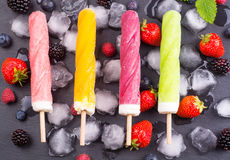 Refreshing ice cream on table. Ice cream or sorbet with ice cubes and mixed fresh fruits Royalty Free Stock Image