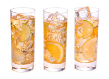 Refreshing Ice Drink. Three glasses of refreshing ice tee with citrus fruits Royalty Free Stock Photo