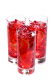 Refreshing Ice Drink. Three glasses of colorful s with citrus fruits Stock Photography