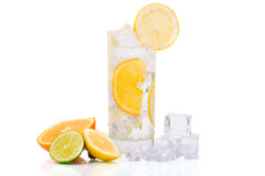 Refreshing Ice Drink. Glass of refreshing ice water with citrus fruits Royalty Free Stock Images