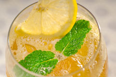 Refreshing Ice tea. Closeup macro with lemon and mint leaves Royalty Free Stock Images