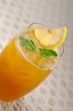 Refreshing Ice tea. Closeup macro with lemon and mint leaves Stock Photography