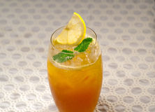 Refreshing Ice tea. Closeup macro with lemon and mint leaves Royalty Free Stock Photo
