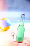 Refreshing iced soda on a hot beach Stock Image
