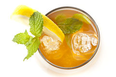 Refreshing Iced Tea with Lemon. Against a background Royalty Free Stock Images