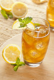 Refreshing Iced Tea with Lemon. Against a background stock image