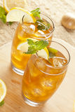 Refreshing Iced Tea with Lemon. Against a background Stock Photo