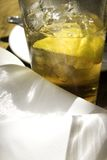 Refreshing Iced Tea with Lemon. A hot day brings out the best - refreshing iced tea with lemon - hold the sugar accompanied by fine white linen Royalty Free Stock Photos