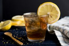 Refreshing Iced Tea with Lemon Rounds. A refreshing iced tea beverage with lemon rounds that's perfect to drink on those hot summer days stock images