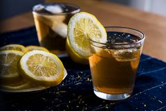 Refreshing Iced Tea with Lemon Rounds. A refreshing iced tea beverage with lemon rounds that's perfect to drink on those hot summer days stock photo